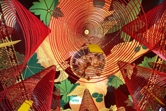 Spiral incense sticks hanging from a ceiling of a Buddhist temple Stock Images