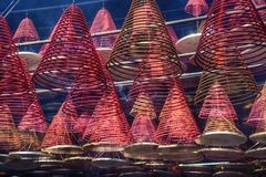 Spiral incense sticks suspended inside the chinese temple stock images