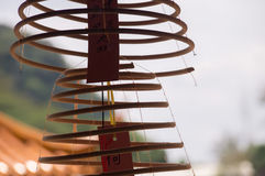 Spiral incenses for prayer in Buddhist Temple Stock Image