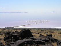 Spiral Jetty swirls in the pink blue water Stock Photo