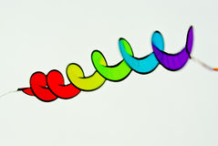 Spiral Kite Flying. Closeup of a colorful, spiral-shaped kite airborne Stock Photography