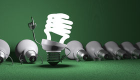 Spiral light bulb character standing and tungsten ones lying. Glowing fluorescent light bulb character in moment of insight standing among many switched off Royalty Free Stock Photos
