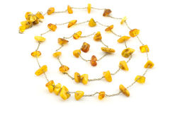 Spiral made of rough amber and chain. Vintage accessory made of natural Baltic amber with metal chain Stock Photography