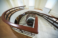 Spiral marble staircase that goes down Stock Images