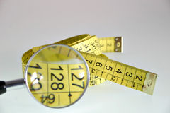 Spiral Measuring Tape. Isolated measuring tape in a spiral Royalty Free Stock Photo