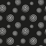 Spiral monochrome seamless texture. Abstract monochrome pattern of white spiral shapes on a black background. Fabric, textile, material seamless texture Royalty Free Stock Image