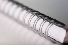 Spiral note book. Focused in frond with soft focus in background Royalty Free Stock Photo
