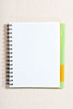 Spiral note pad. Blank spiral note pad on wood desk Royalty Free Stock Photo