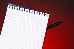 Spiral note pad. A Close-up look at  a spiral note book with a black pencil on top Royalty Free Stock Photo