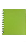 A spiral notebook. A green cover of a spiral notebook Stock Images
