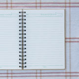 A spiral notebook. Stock Image