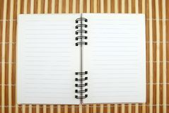 Spiral Notebook. Blank Spiral Notepad on Bamboo Pad Open for Writing Stock Image