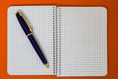 Spiral Notebook with blue Pen. A series of photos with stationery items Stock Image