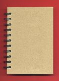 Spiral Notebook Cover. Image of spiral notebook cover over red background Royalty Free Stock Photography