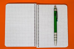 Spiral Notebook with green Pen. A series of photos with stationery items Stock Images