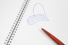 Spiral notebook with heart Royalty Free Stock Images
