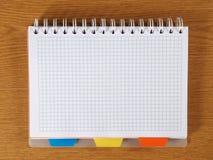 Spiral Notebook. Open spiral notebook lying on desk Stock Image