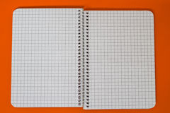 Spiral Notebook at orange Background. A series of photos with stationery items Royalty Free Stock Photo