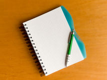 Spiral notebook with pen Royalty Free Stock Photo