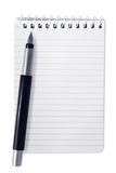 Spiral Notebook with Pen. Small spiral notebook with fountain pen, isolated on white Royalty Free Stock Photo