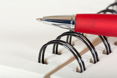 Spiral notebook with pen Stock Images