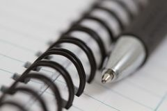 Spiral notebook and pen Stock Photos