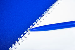 Spiral notebook with pen Royalty Free Stock Photography