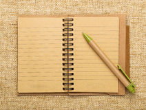 Spiral notebook and pen Stock Photography
