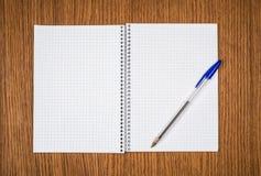 Spiral notebook and pen Stock Photos