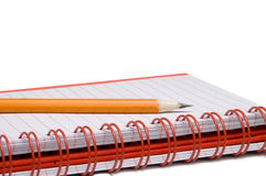 Spiral notebook and pencil Stock Photos