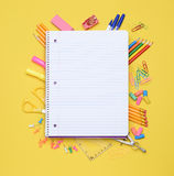 Spiral Notebook on School Supplies. An open spiral notebook laying on assorted school supplies. Back to School concept. Equipment includes, pens, pencils Royalty Free Stock Photos