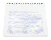 Spiral notebook with squared paper sheets Royalty Free Stock Photography