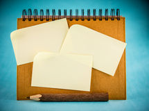Spiral notebook and sticky papers Royalty Free Stock Photography