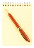 Spiral notebook and wooden pen Royalty Free Stock Photo