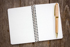 Spiral notebook and wooden pen Royalty Free Stock Image