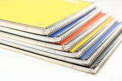 Spiral Notebooks. Six spiral notebooks stacked on a white background Stock Image