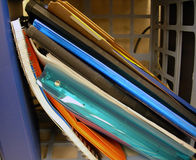 Spiral notebooks. Stack of spiral notebooks and binders on desk Royalty Free Stock Images
