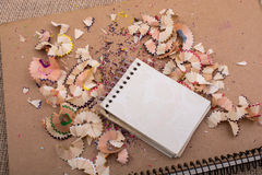 Spiral notebooks amid colorful pencil trash. Spiral notebooks amid some colorful pencil trash stock photos