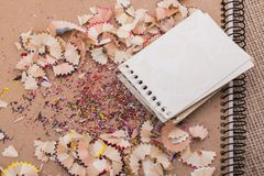 Spiral notebooks amid colorful pencil trash. Spiral notebooks amid some colorful pencil trash royalty free stock image