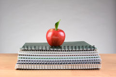 Spiral Notebooks and Red Apple Royalty Free Stock Images
