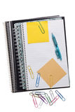Spiral notebooks with sticky notes paper clips and pen Royalty Free Stock Photography