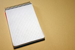 Spiral notepad. On beige background Stock Images