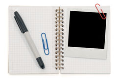 Spiral notepad. And blank instant photo isolated on a white Stock Photos