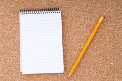 Free Spiral Notepad And Pencil Over Cork Surface Stock Images - 5543074