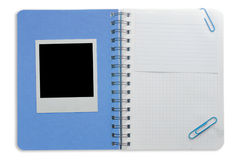Spiral notepad and black instant photo Stock Image