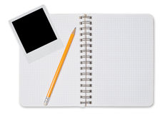 Spiral notepad and black instant photo Royalty Free Stock Images