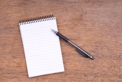Spiral Notepad and Mechanical Pencil on wood Royalty Free Stock Image
