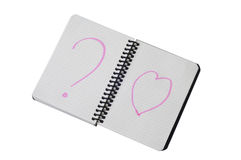 Spiral notepad with path on the Heart and Question. Mark On it Royalty Free Stock Photo