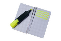 Spiral notepad with path highlighted. On some rows with highlighter pen Royalty Free Stock Image