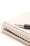 Spiral Notepad and Pen. Blank lined spiral notepad and pen isolated on a white background Royalty Free Stock Photography